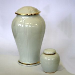 white decorative urn ashes