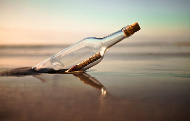 scattering ashes out at sea in a message bottle