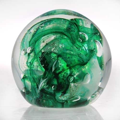 green Memorial ashes into glass paperweight