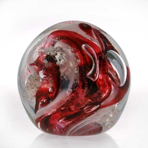 red Memorial ashes into glass paperweight