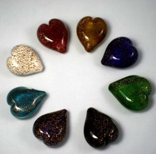 Handheld heart ashes into glass
