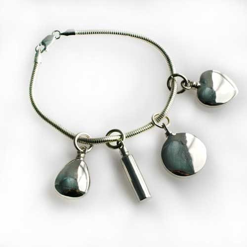 Charms on a bracelet - Ashes Jewellery