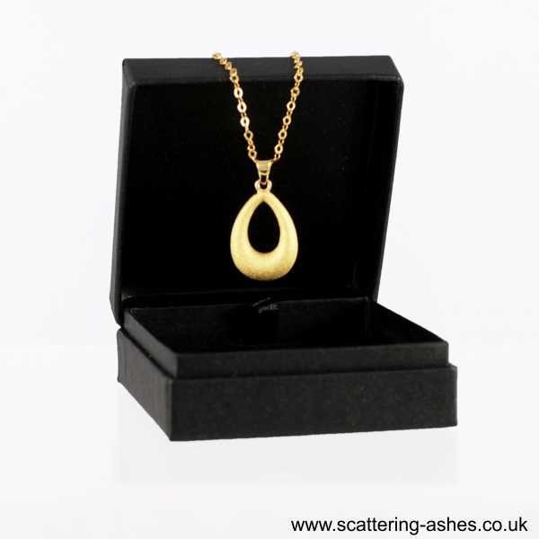 gold teardrop pendant